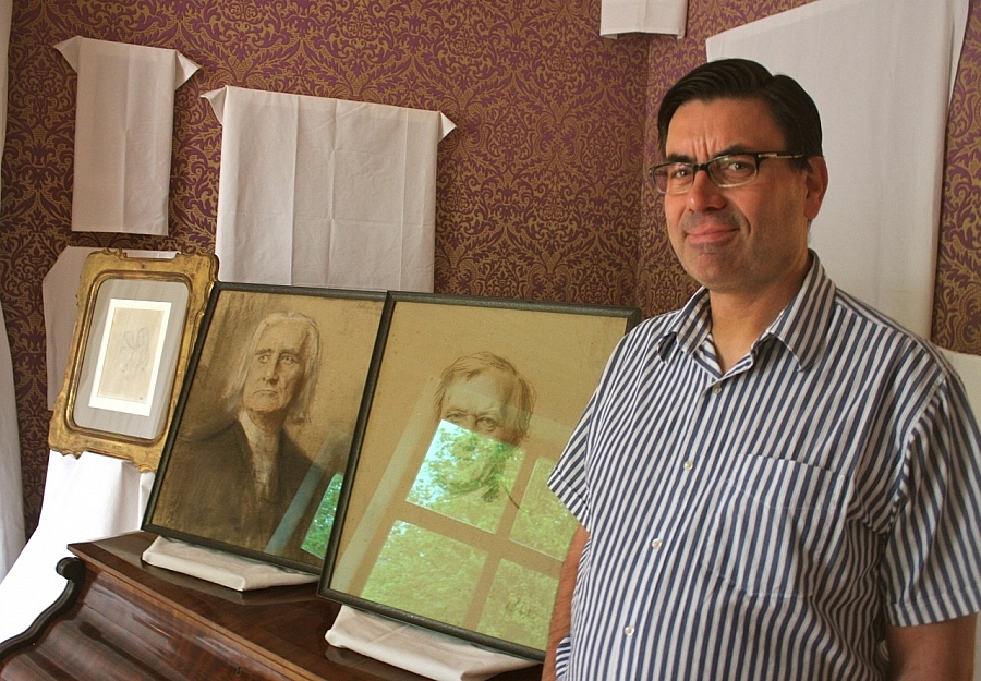 Museum director Sven Friedrich at Villa Wahnfried with Liszt and Wagner portraits. Photo: Ehrnrooth