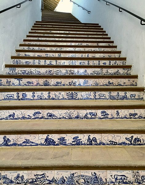 Stairs and azulejos bullfighting arena Ronda Photos - mountaintop city in Spain's Malaga province.